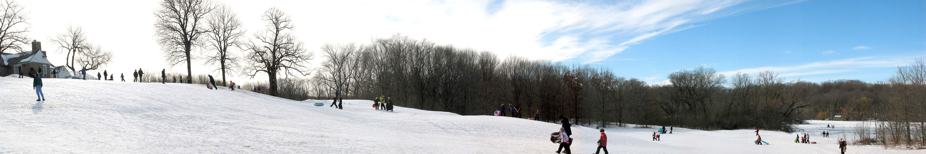 Sledding at Whitnal County Park clubhouse on a sunny day